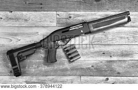 Home Security 12 Gauge Short Barrel Semi- Auto Firearm/ Shotgun In Black And White.