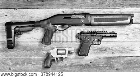 Home Security Shotgun,revolver And Semi Automatic Pistol In Black And White.