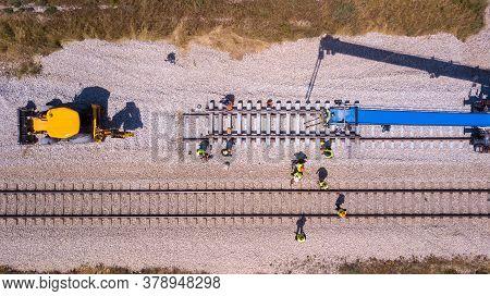 Rail Tracks Maintenance Process. Railroad Workers Repairing A Broken Track.