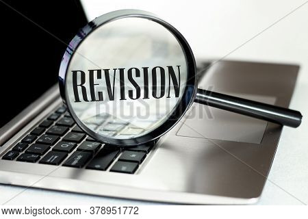 Laptop Computer With Magnifying Glass, Concept Of Search. Revision