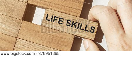 Male Hand Pushes A Piece Of Wood With Text Life Skills From Other Pieces Of Wood
