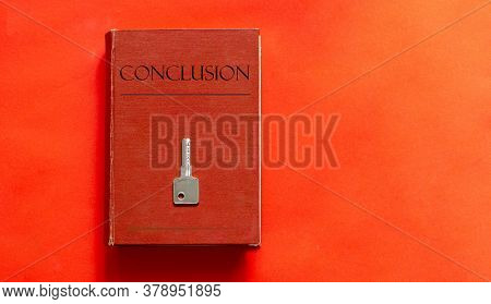 Red Book With Text Conclusion And A Key On A Red Background