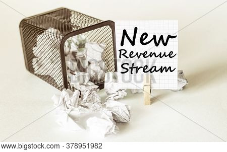 White Lumps Of Paper Fall Out Of The Case To The Paper In The Inscription New Revenue Stream
