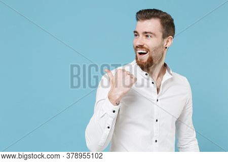Cheerful Young Bearded Man Guy 20s In White Classic Shirt Isolated On Pastel Blue Wall Background St