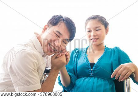 Husband Shaking Hands Pregnant Wife He Is Happy To Have Children. Family Building Concept Pregnancy