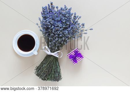 Lavender Bouquet, Coffe And Little Present With Bow On Beige Background. Top View, Flat Lay,copy Spa