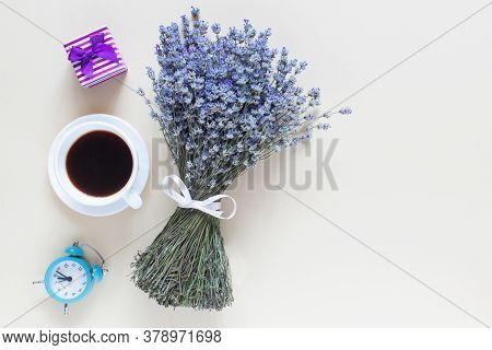 Lavender Bouquet, Coffe,clock  And Little Present On Beige Background. Top View, Flat Lay,copy Space