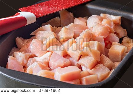 Slicing Pieces Of Diced Chicken Breast. Selective Focus.