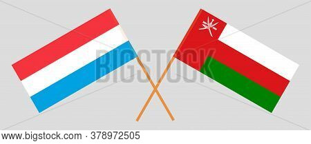 Crossed Flags Of Oman And Luxembourg. Official Colors. Correct Proportion. Vector Illustration