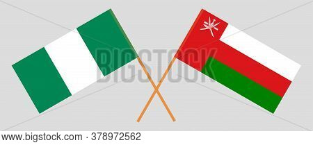 Crossed Flags Of Oman And Nigeria. Official Colors. Correct Proportion. Vector Illustration
