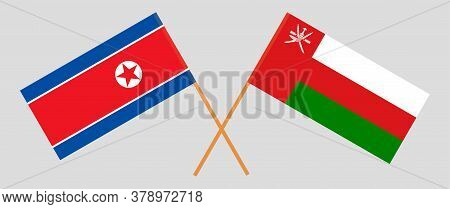 Crossed Flags Of Oman And North Korea. Official Colors. Correct Proportion. Vector Illustration