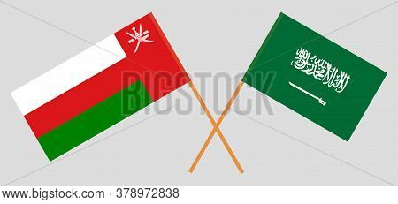 Crossed Flags Of Oman And The Kingdom Of Saudi Arabia. Official Colors. Correct Proportion. Vector I