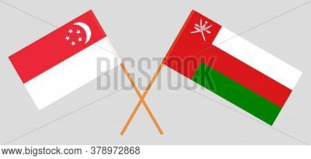 Crossed Flags Of Oman And Singapore. Official Colors. Correct Proportion. Vector Illustration