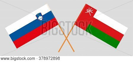 Crossed Flags Of Oman And Slovenia. Official Colors. Correct Proportion. Vector Illustration