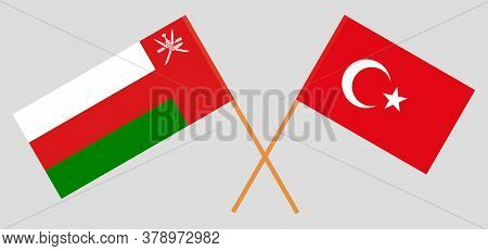 Crossed Flags Of Oman And Turkey. Official Colors. Correct Proportion. Vector Illustration