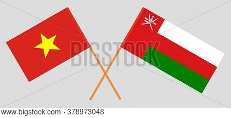 Crossed Flags Of Oman And Vietnam. Official Colors. Correct Proportion. Vector Illustration