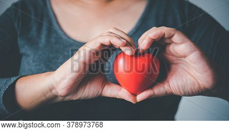 Woman Hand Holding A Heart Symbol, World Heart Day, Donation, Caring For Charity, Concept