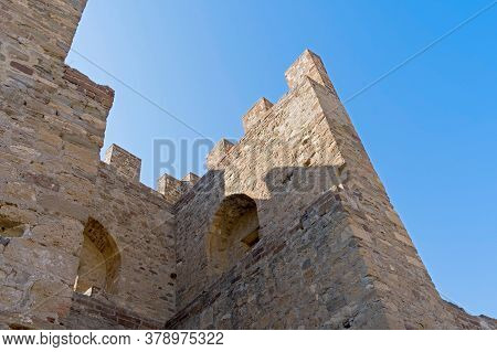 Ancient Historic Genoese Castle Or Fortress Against The Blue Sky