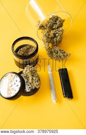 Marijuana Nature Bud. The Pot Leaves On Buds. Cannabis Weed Bud And Grinder. Thc Cbd. Yellow Backgro
