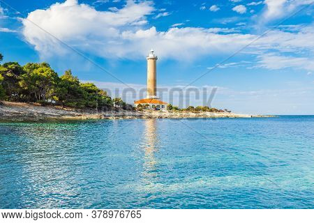Lighthouse Of Veli Rat On The Island Of Dugi Otok, Croatia, Beautiful Sea Bay In Foreground