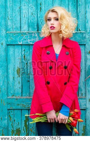 High Fashion Model Girl Posing On Old Wooden Texture Background. Fashion Art Portrait Of Beautiful E