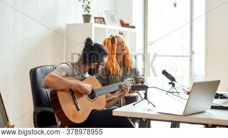 New Song. Man Playing Guitar And Woman Singing. Couple Of Musicians Recording Video Blog Or Vlog Whi