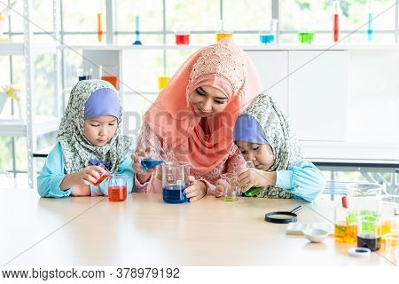 Muslim Teachers Wearing Islamic Clothes Are Teaching Muslim Children About Scientific Experiments In