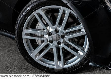 Novosibirsk/ Russia - July 27 2020: Audi A7, Car Wheel With Alloy Wheel And New Rubber On A Car Clos