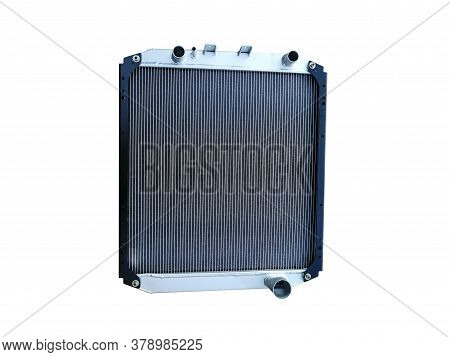 New Aluminum Car Radiator Car Cooling System On An Isolated White Background. Spare Parts.
