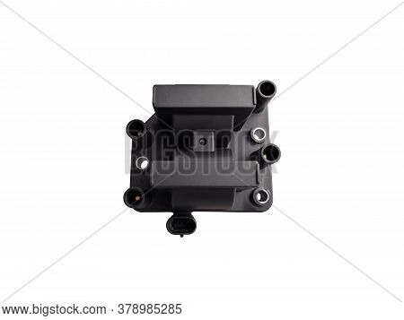 New Car Ignition Coil On An Isolated White Background. Component Of The Ignition System. Spare Parts