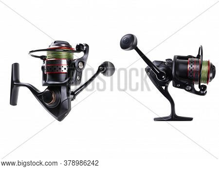 Fishing Tackle. Fishing Reel With The Line Isolated On White Background With Clipping Path. Modern F
