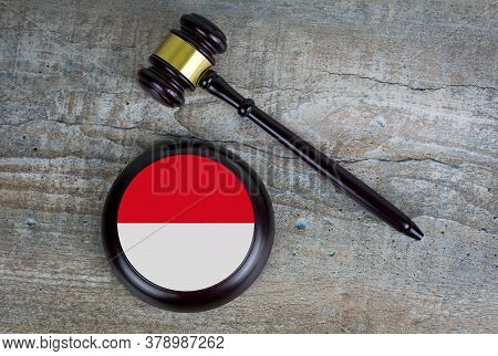 Wooden Judgement Or Auction Mallet With Of Indonesia Flag. Conceptual Image.