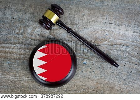 Wooden Judgement Or Auction Mallet With Of Bahrain Flag. Conceptual Image.