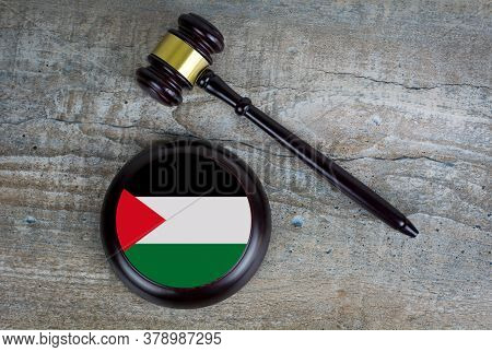 Wooden Judgement Or Auction Mallet With Of Palestine Flag. Conceptual Image.