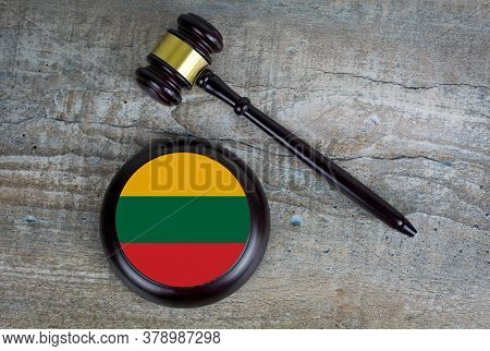 Wooden Judgement Or Auction Mallet With Of Lithuania Flag. Conceptual Image.