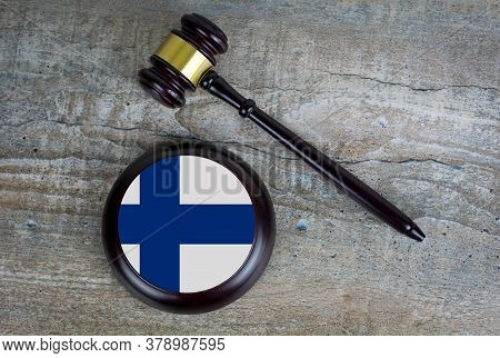 Wooden Judgement Or Auction Mallet With Of Finland Flag. Conceptual Image.
