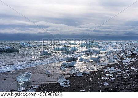 Amazing Picturesque View Of Black Sand Beach With Iceberg Pieces On Diamond Beach Near Jokulsarlon L