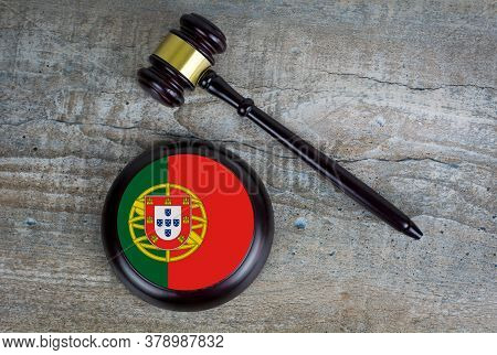 Wooden Judgement Or Auction Mallet With Of Portugal Flag. Conceptual Image.