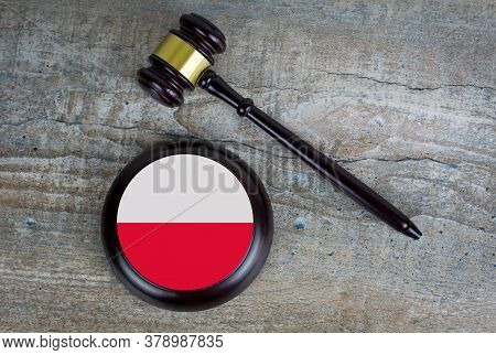 Wooden Judgement Or Auction Mallet With Of Poland Flag. Conceptual Image.