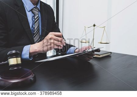 Picture Of The Male Lawyer Is Providing Service To Consult Business Dispute.