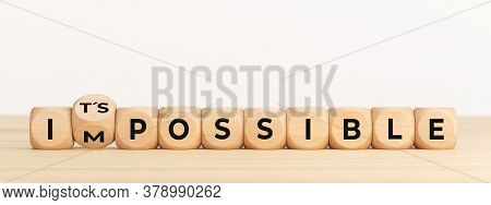 Changing Word Impossible Into Its Possible. Wooden Dice With Text On Table. Copy Space