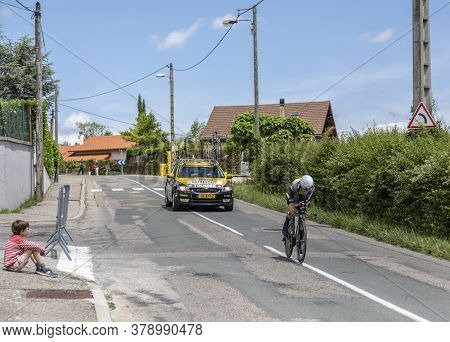 Bourgoin-jallieu, France - 07, May, 2017: A Kid On The Roadside Is Looking Tothe Dutch Cyclist Antwa