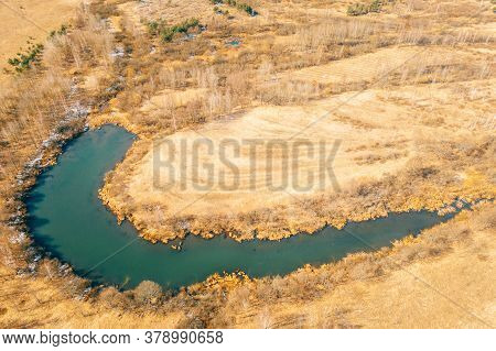 Belarus. Aerial View Of Dry Grass And Curved Bog Marsh Swamp Wetland Landscape In Early Spring Day.