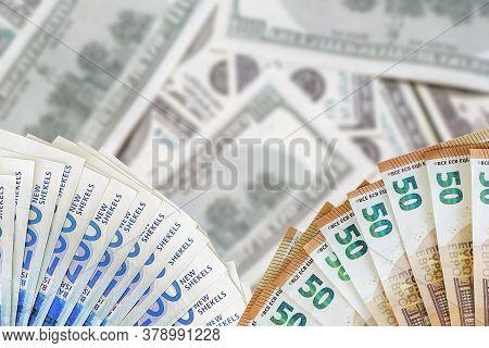 Fan Euro Banknotes And New Israeli Shekel. Fan 50 Euro Banknotes And 200 Israeli Money Banknotes On