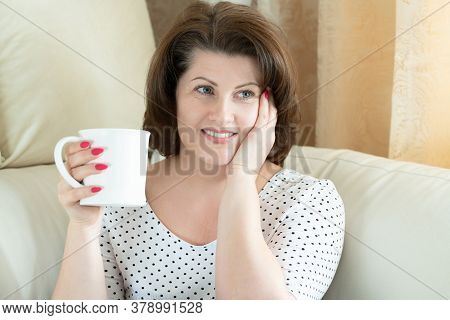 Woman Dreaming With A Cup In Her Hands