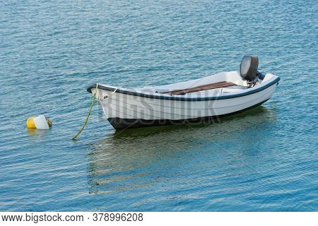 Wooden Fishing Boat With A Motor Anchored In The Sea, Calm Natural Landscape