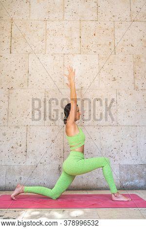Spanish Woman Doing Yoga Outdoors. Yoga Concept.