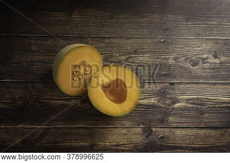 Fresh Cantaloupe On A Wood Plank Board Background