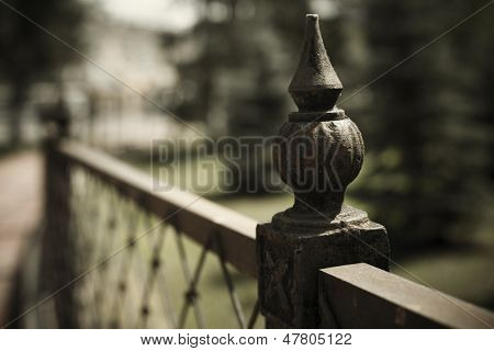 urban concept with wrought iron fence detail ( selective focus  on nearest part)