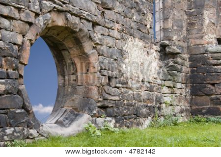 old cloister Ruin wall with round window poster